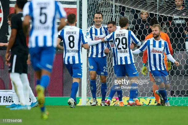 The players of OB Odense celebrate the 0-1 goal from Bashkim Kadrii during the Danish 3F Superliga match between FC Midtjylland and OB Odense at MCH...