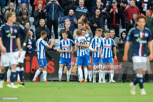 The players of OB Odense celebrate the penalty goal from Nicklas Helenius during the Danish Superliga match between OB Odense and AGF Arhus at Nature...