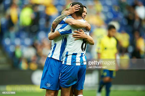 The players of OB Odensen celebrating after the Danish Alka Superliga match between Brondby IF and OB Odense at Brondby Stadion on July 26, 2015 in...