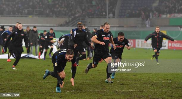 The players of Paderborn celebrate after winning the DFB Cup match between SC Paderborn and FC Ingolstadt at Benteler Arena on December 19 2017 in...
