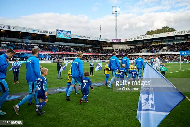 The players of Randers FC walk on to the pitch prior to the Danish 3F Superliga match between Randers FC and AGF Arhus at Cepheus Park Randers on...