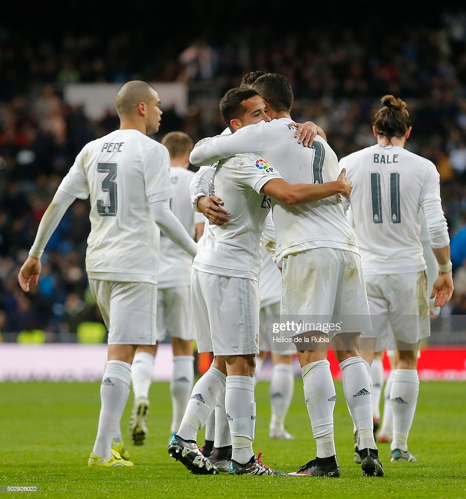 The players of Real Madrid celebrate after scoring during the La Liga match between Real Madrid CF and Real Sociedad at Estadio Santiago Bernabeu on December 30, 2015 in Madrid, Spain.