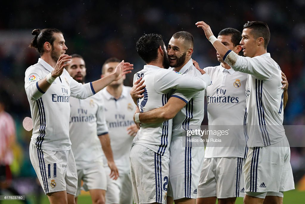 The players of Real Madrid celebrate after scoring during the La Liga match between Real Madrid CF and Athletic Club at Estadio Santiago Bernabeu on October 23, 2016 in Madrid, Spain.
