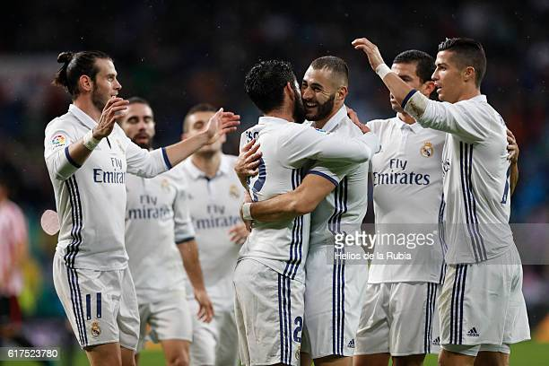 The players of Real Madrid celebrate after scoring during the La Liga match between Real Madrid CF and Athletic Club at Estadio Santiago Bernabeu on...