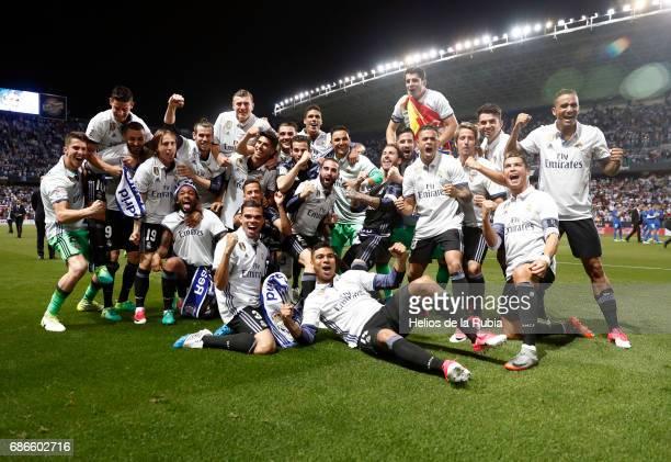 The players of Real Madrid celebrate after scoring during the La Liga match between Malaga CF and Real Madrid CF at Estadio La Rosaleda on May 21...