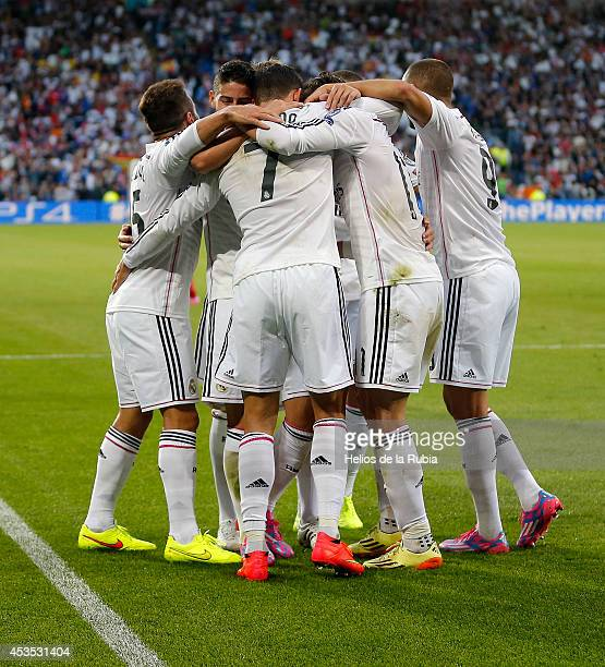 The players of Real Madrid celebrate after scoring during the UEFA Super Cup match between Real Madrid and Sevilla at Cardiff City Stadium on August...