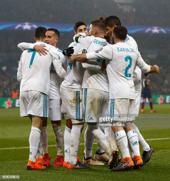 The players of Real Madrid celebrate after scoring during the UEFA Champions League Round of 16 Second Leg match between Paris SaintGermain and Real...