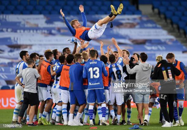 The players of Real Sociedad throw their teammate David Zurutuza of Real Sociedad in the air after the Liga match between Real Sociedad and Sevilla...