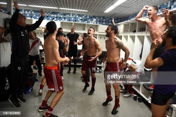 The players of River Plate celebrate in the dressing room after their victory in the semifinal match between Gremio and River Plate as part of Copa...