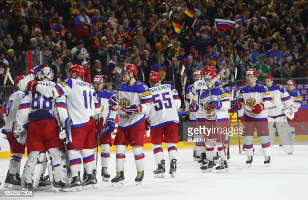 The players of Russia celebrate their win after the 2017 IIHF Ice Hockey World Championship game between Germany and Russia at Lanxess Arena on May 8...