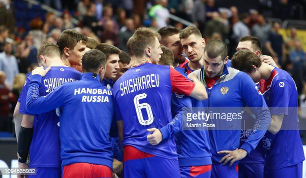 The players of Russia look dejected after the 26th IHF Men's World Championship group A match between Russia and Brazil at Mercedes-Benz Arena on...