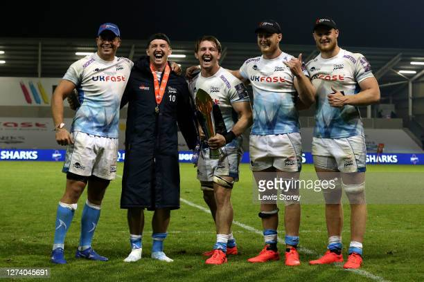 The players of Sale Sharks hold the trophy following victory in the Premiership Rugby Cup Final between Sale Shark and Harlequins at AJ Bell Stadium...
