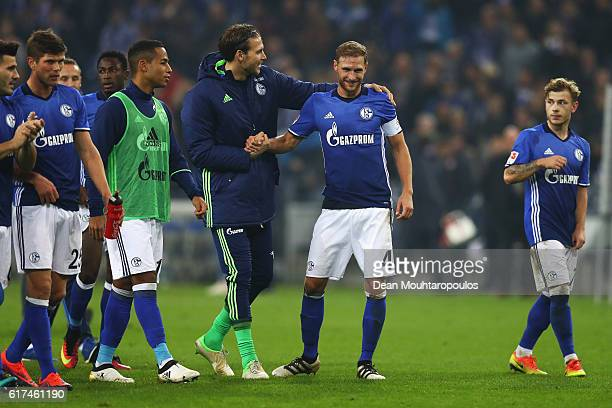The players of Schalke lead by captain, Benedikt Howedes celebrate victory after the Bundesliga match between FC Schalke 04 and 1. FSV Mainz 05 at...
