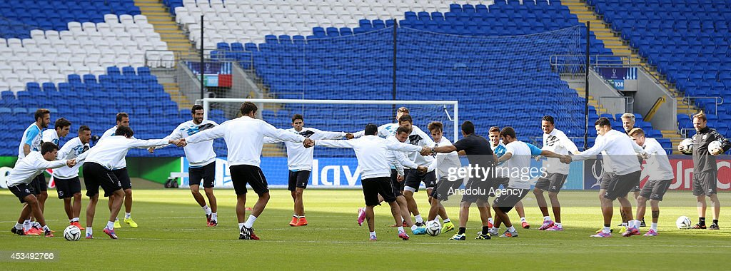 The players of Sevilla training prior to the UEFA Super Cup match between Real Madrid and Sevilla at Cardiff City Stadium on August 11, 2014 in Cardiff, Wales.