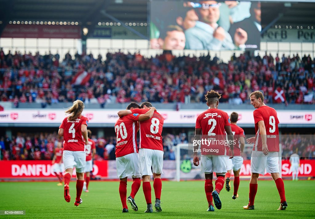 The players of Silkeborg IF celebrate after the 2-1 goal scored by Marc Rochester Sorensen of Silkeborg IF during the Danish Alka Superliga match between Silkeborg IF and AGF Aarhus at Jysk Park on July 31, 2017 in Silkeborg, Denmark.