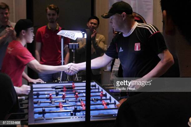 The players of Singapore and USA shows sportsmanship during the Doubles Championship trophy on the 'Table Soccer World Tour 2016'