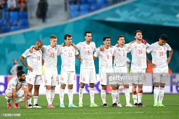 The players of Spain look on from the half way line during the penalty shoot out during the UEFA Euro 2020 Championship Quarter-final match between...