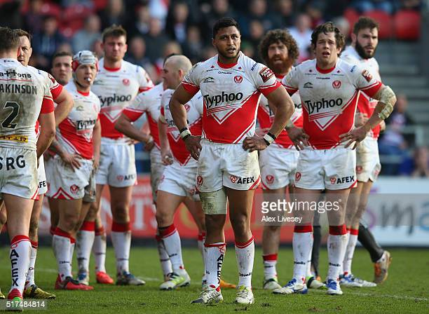 The players of St Helens look on after Matty Smith of Wigan Warriors had scored a try during the First Utility Super League match between St Helens...