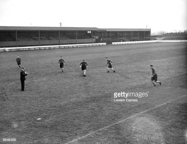 The players of Swindon Town Football Club are put through their paces during a training session