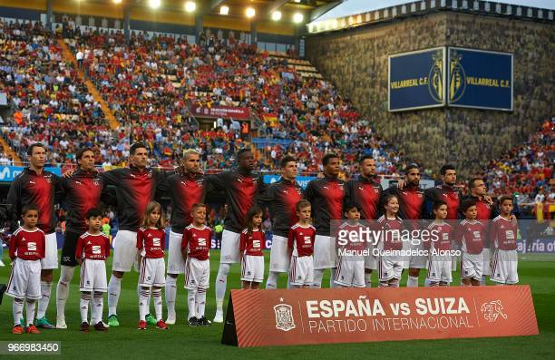 The players of Switzerland line up for their national anthem prior to the International Friendly match between Spain and Switzerland at Estadio de La...