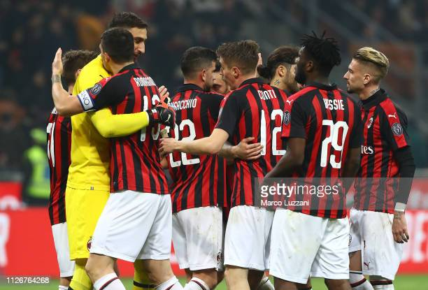 The players of the AC Milan celebrate a victory at the end of the Serie A match between AC Milan and Empoli at Stadio Giuseppe Meazza on February 22...