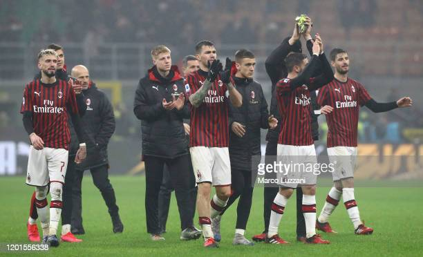 The players of the AC Milan celebrate a victory at the end of the Serie A match between AC Milan and Torino FC at Stadio Giuseppe Meazza on February...