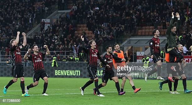 The players of the AC Milan celebrate a victory at the end of the Serie A match between AC Milan and Juventus FC at Stadio Giuseppe Meazza on October...