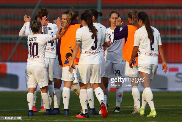 The players of the ACF Fiorentina celebrate a victory at the end of the Women Coppa Italia match between AC Milan and ACF Fiorentina at Stadio...
