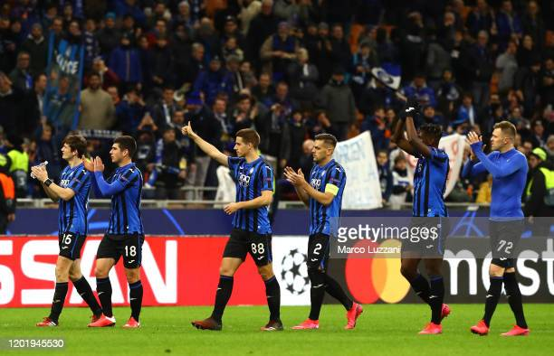 The players of the Atalanta celebrate a victory at the end of the UEFA Champions League round of 16 first leg match between Atalanta and Valencia CF...