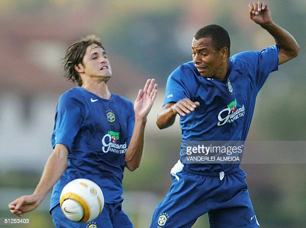 The players of the Brazilian national football team Edmilson and Gilberto Silva fight for the ball during a training session at Teresopolis 100 km...