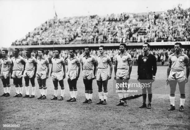 The players of the Brazilian soccer team line up on the pitch for the national anthem in front of 53000 spectators before the start of the 1958 World...