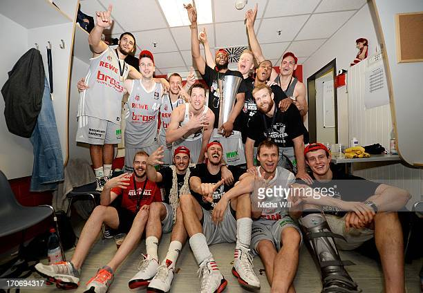 The players of the Brose Baskets Bamberg celebrate their victory after winning the finals of the Beko BBL playoffs between Brose Baskets and EWE...