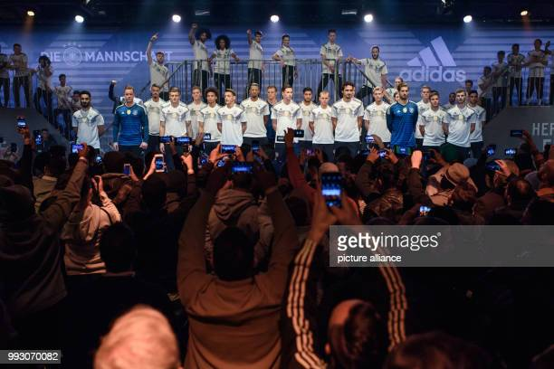 The players of the German men's national football team pose with their new juerseys during the presentation of the new Adidas out fir for the Russia...