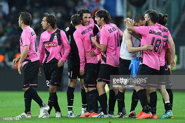 The players of the Juventus FC celebrate a victory at the end of the Serie A match between Juventus FC and SSC Napoli at Juventus Arena on April 1...