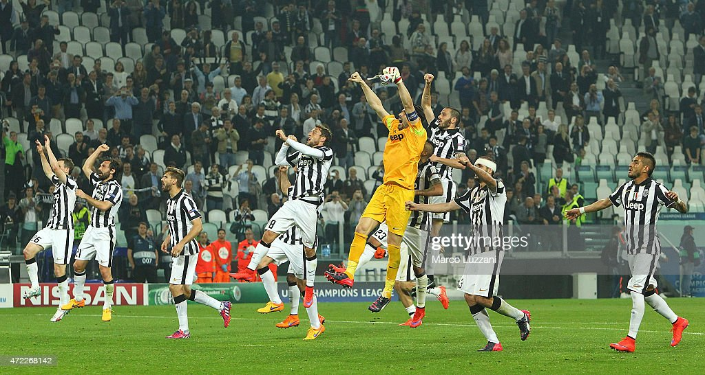 The players of the Juventus FC celebrate a victory at the end of the UEFA Champions League semi final match between Juventus and Real Madrid CF at Juventus Arena on May 5, 2015 in Turin, Italy.