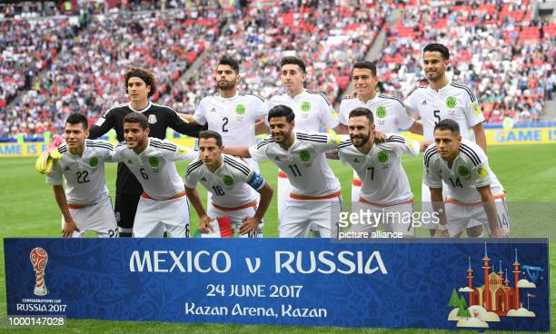 The players of the Mexican squad pose for a group photo ahead of the group stage match pitting Mexico against Russia at the Kazan Arena in Kazan...
