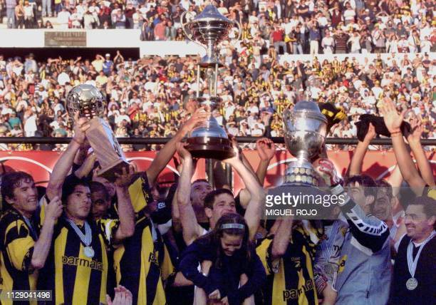 The players of the Penarol Soccer Club Jose De Los Santos Gabriel Cedres Antonio Pacheco Claudio Flores and Carlso Arguilera celebrate their trophy...