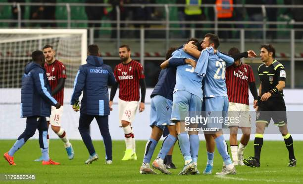 The players of the SS Lazio celebrate a victory at the end of the Serie A match between AC Milan and SS Lazio at Stadio Giuseppe Meazza on November 3...