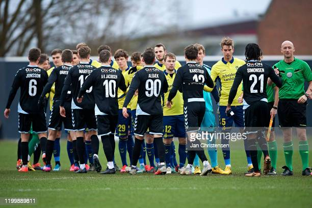 The players of the two teams shake hands prior to the testmatch between Brondby IF and SonderjyskE at Brondby Stadion on February 10, 2020 in...