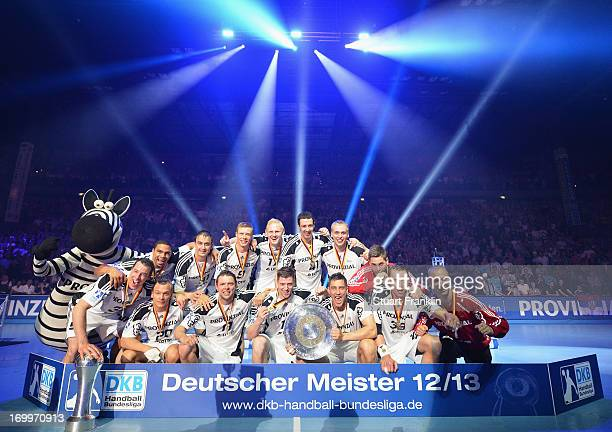 The players of THW Kiel present the Bundesliga trophy to the fans at the Sparkasse Arena on June 5 2013 in Kiel Germany