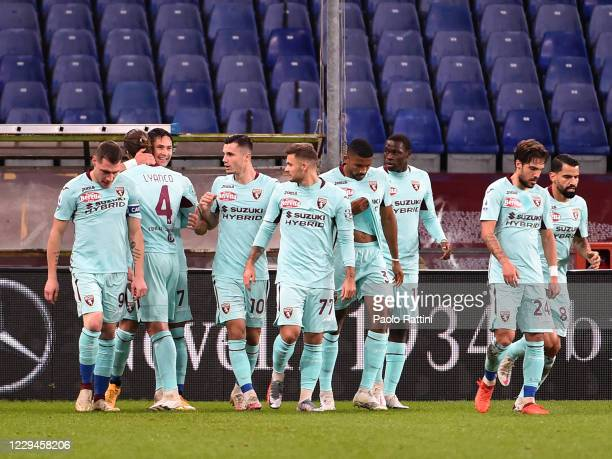 The players of Torino FC celebrate after the opening goal of Sasa Lukic during the Serie A match between Genoa CFC and Torino FC at Stadio Luigi...