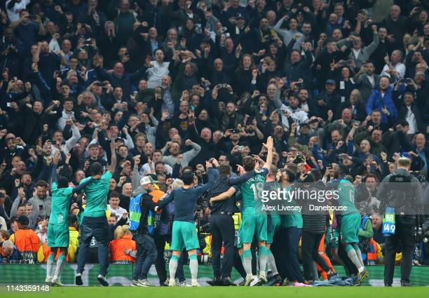 The players of Tottenham Hotspur celebrate in front of their supporters after the UEFA Champions League Quarter Final second leg match between...