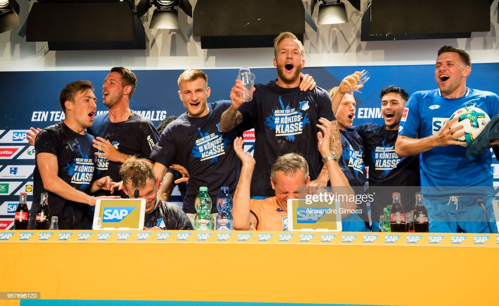The players of TSG 1899 Hoffenheim celebrating the win with Julian Nagelsmann, head coach of TSG 1899 Hoffenheim, during the press conference after the final whistle during the Bundesliga match between TSG 1899 Hoffenheim and Borussia Dortmund at the Wirsol Rhein-Neckar-Arena on May 12, 2018 in Sinsheim, Germany.