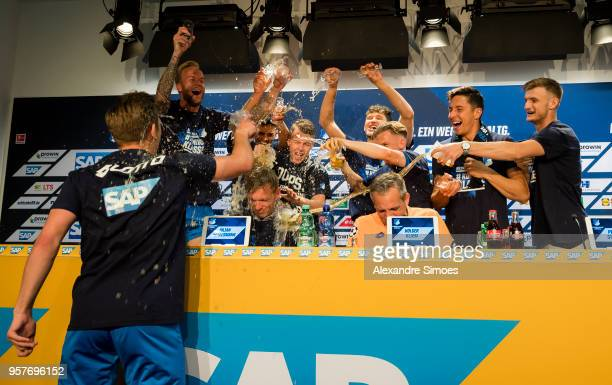 The players of TSG 1899 Hoffenheim celebrating the win with Julian Nagelsmann head coach of TSG 1899 Hoffenheim during the press conference after the...