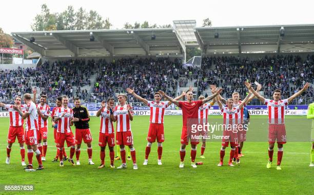 The players of Union Berlin celebrate the 1:2 win after the game between FC Erzgebirge Aue and FC Union Berlin on september 30, 2017 in Aue, Germany.