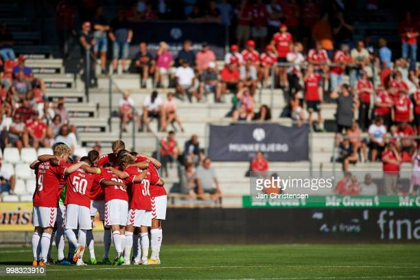 The players of Vejle Boldklub form a cluster prior to the Danish Superliga match between Vejle Boldklub and Hobro IK at Vejle Stadion on July 13 2018...