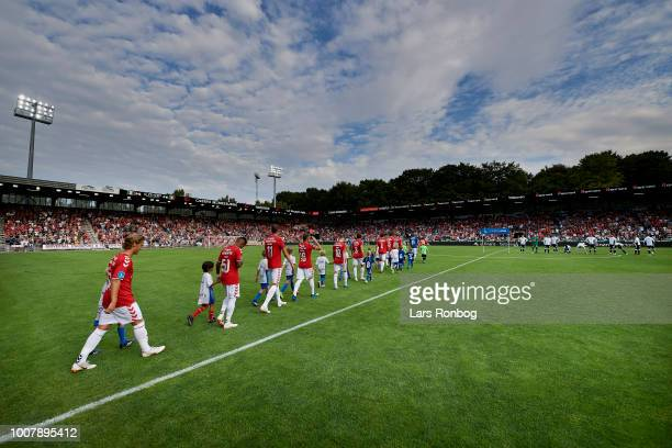 The players of Vejle Boldklub walks on to the pitch prior to the Danish Superliga match between Vejle Boldklub and AGF Aarhus at Vejle Stadion on...