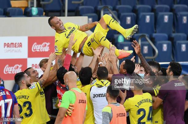 The players of Villarreal lift Santi Cazorla of Villarreal in the air after his last match for the club after the Liga match between Villarreal CF...