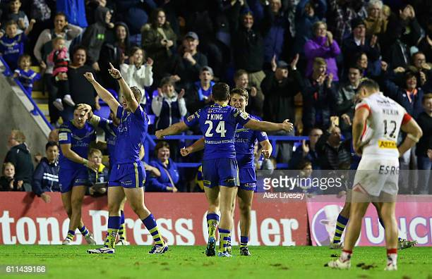 The players of Warrington Wolves celebrate after victory over St Helens in the First Utility Super League Semi Final match between Warrington Wolves...