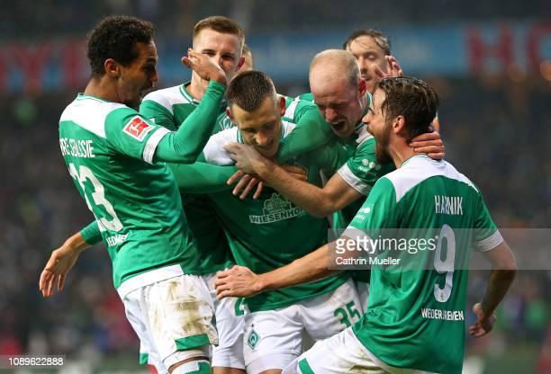 The players of Werder Bremen celebrate after scoring during the Bundesliga match between SV Werder Bremen and Eintracht Frankfurt at Weserstadion on...